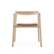 contemporary chair / with armrests / upholstered / solid wood
