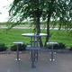 contemporary dining table / steel / round / outdoor