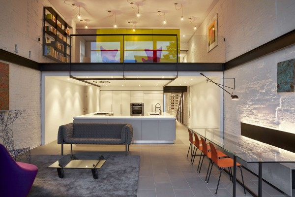 A bright modern row house redone for a fun couple with a love of cooking