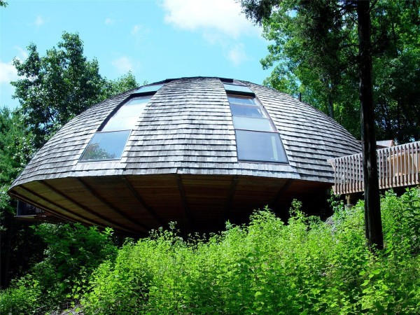 A house shaped like a flying saucer takes earthling design to new heights and shapes