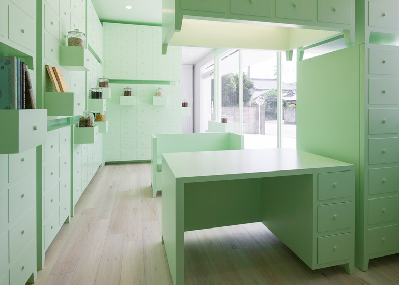 Japanese Acupuncture Clinic By Id Inc Is Lined With Mint Green Cabinets