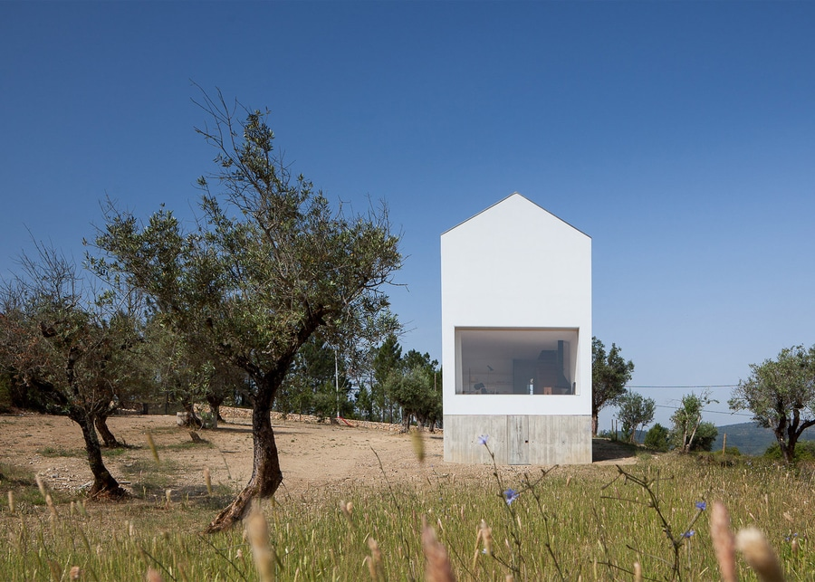 joo mendes ribeiro slots concrete wine cellar below gabled house in rural portugal