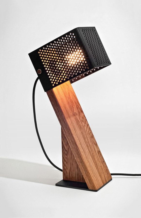 Oblic table lamp is handcrafted from contrasting materials oblic table lamp is handcrafted from contrasting materials mozeypictures Images