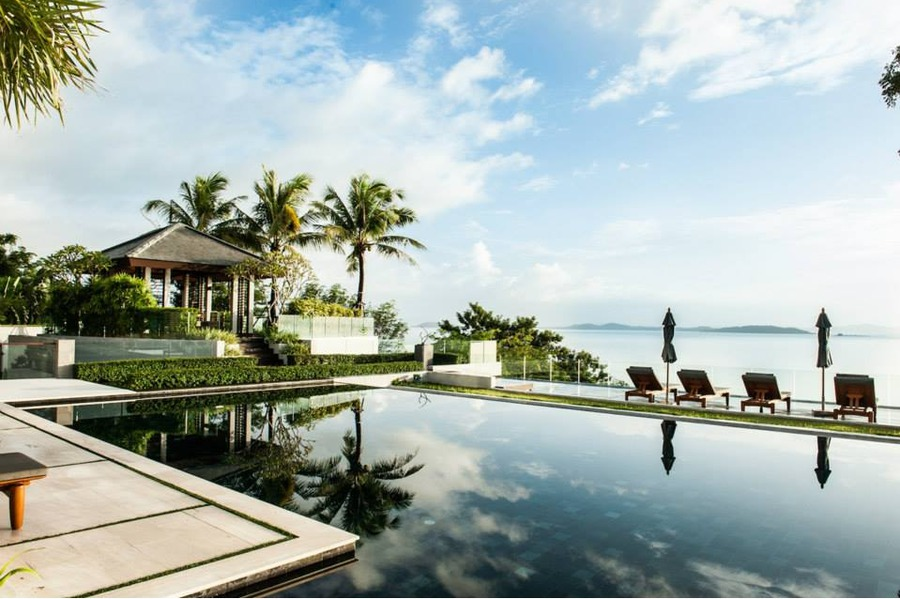 Thai style villa sarawin with gorgeous wood furnishings and sweeping bay views