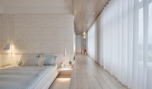 White walls and in floor storage make this creative house design special