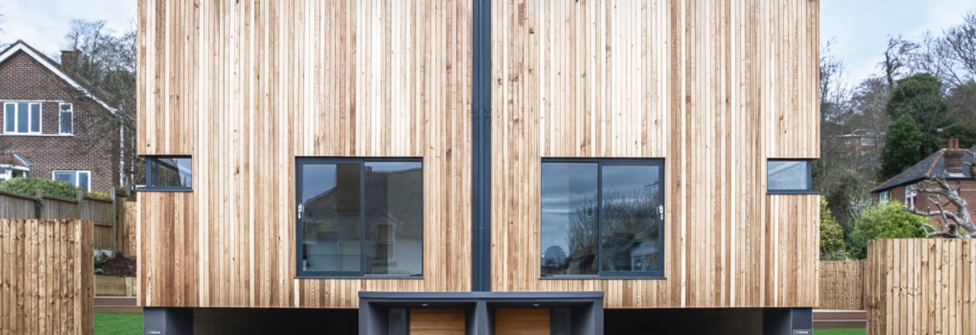 Adam Knibb\'s twin wooden homes seem to hover above the ground ...