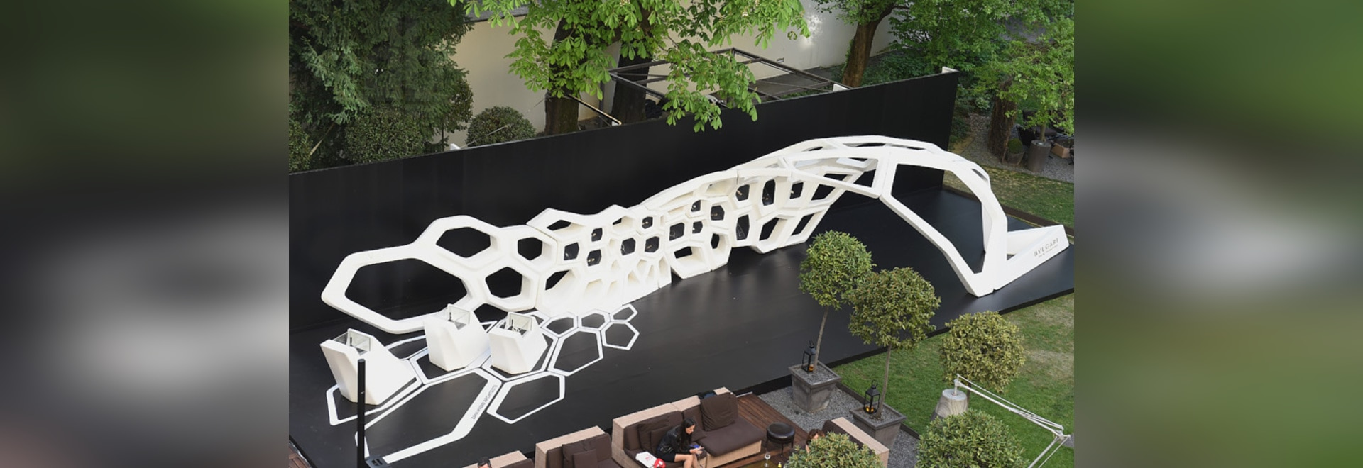an aerial view of the installation set in the garden of the bulgari hotel