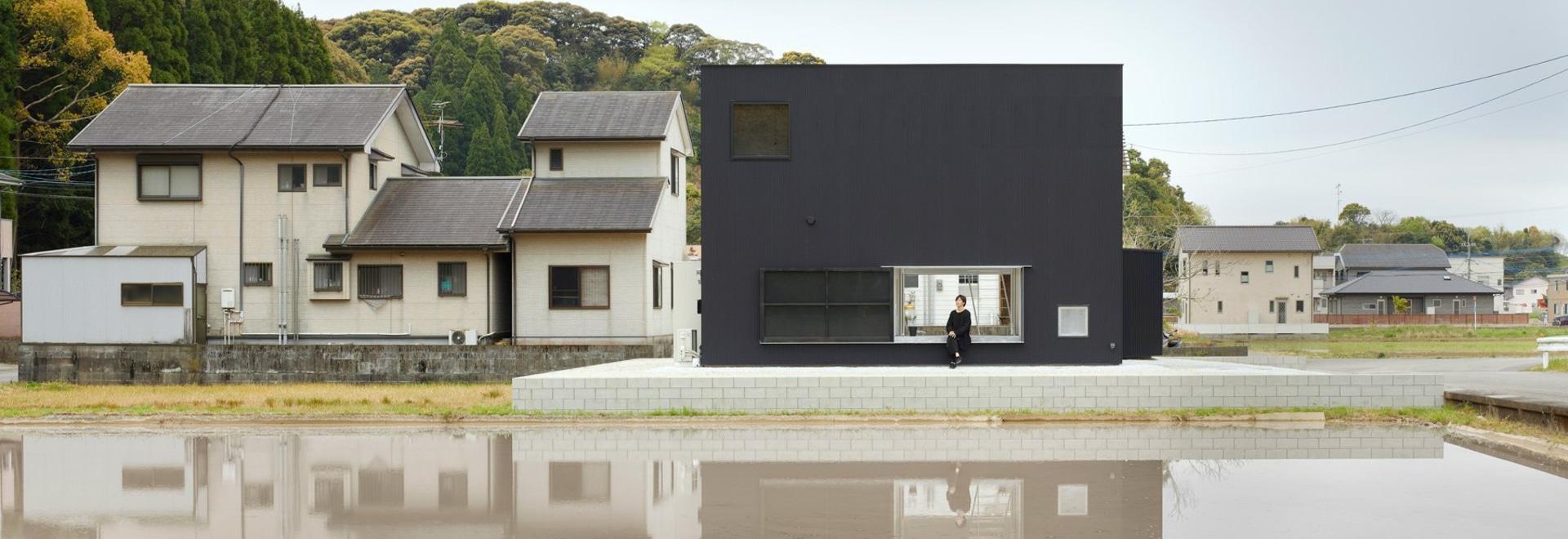 atelier kenta eto wraps cube house in black aluminum in kadokawa, japan