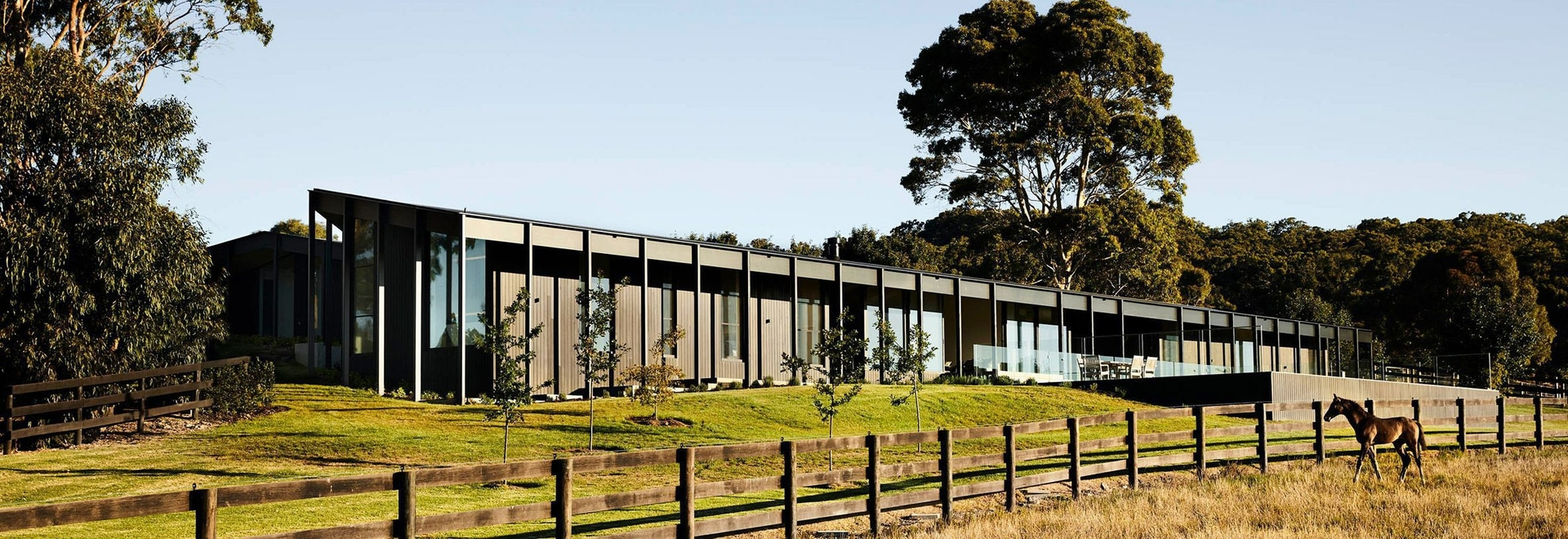 Blackened Wood Siding Covers This Modern Farm House In Rural Australia