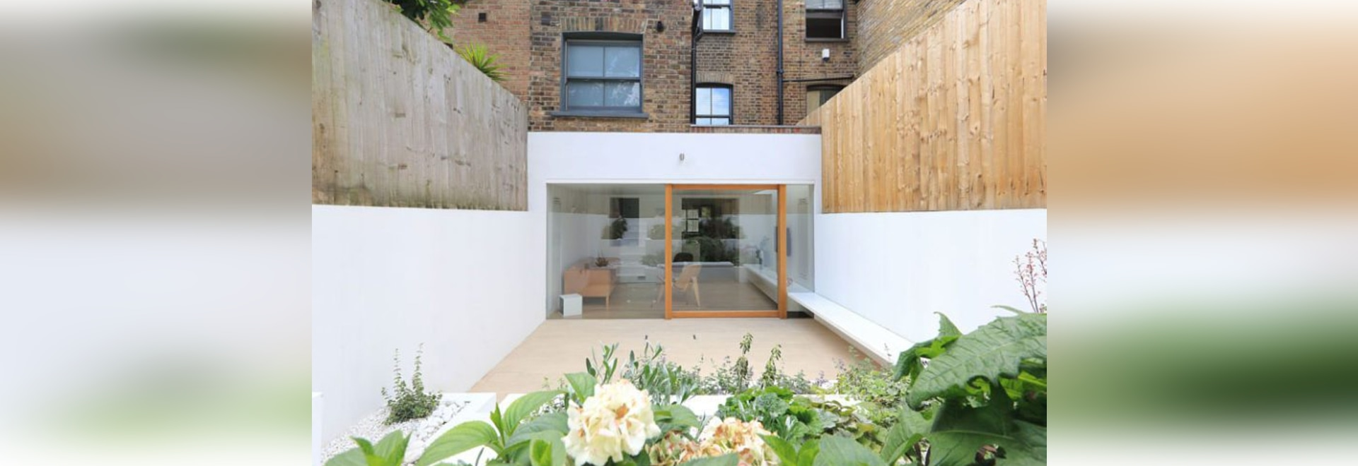A Bright White Dining Room Extension And Terraced Garden Were Added To This East London Home