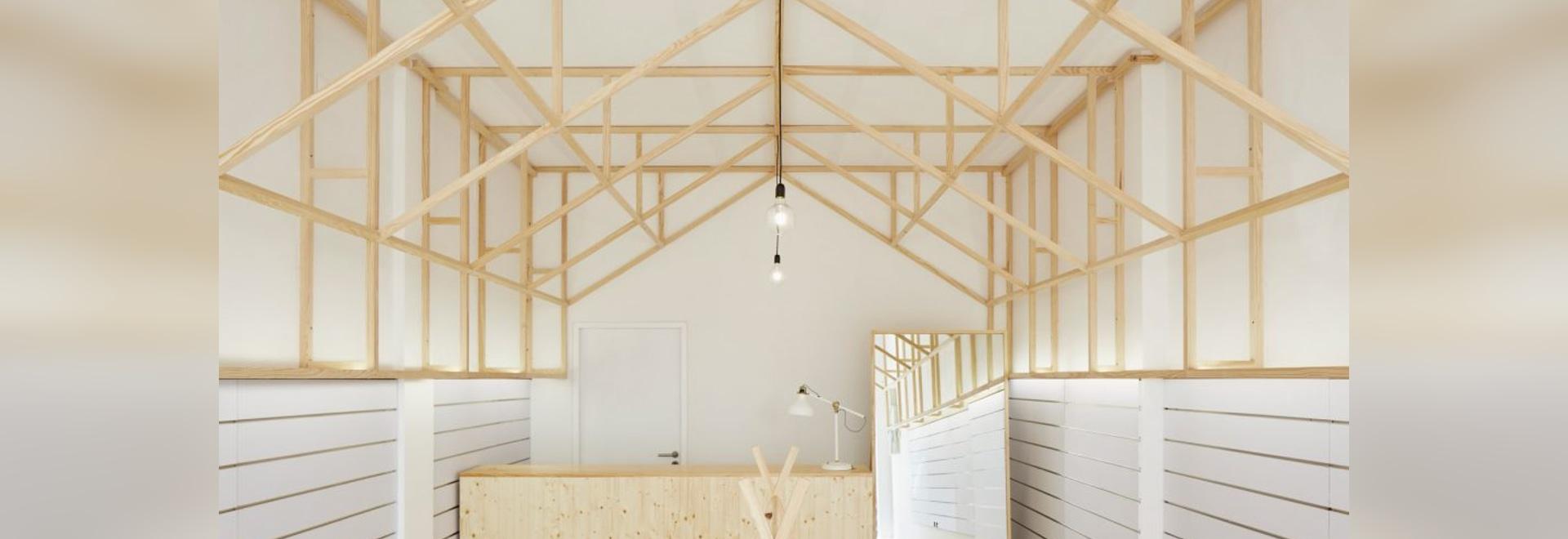 Bruno Lucas Dias adds timber skeleton to Portuguese accessories boutique