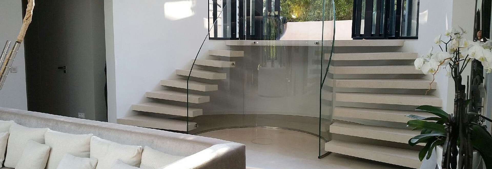 Clear curved, bent glass railing Glassy