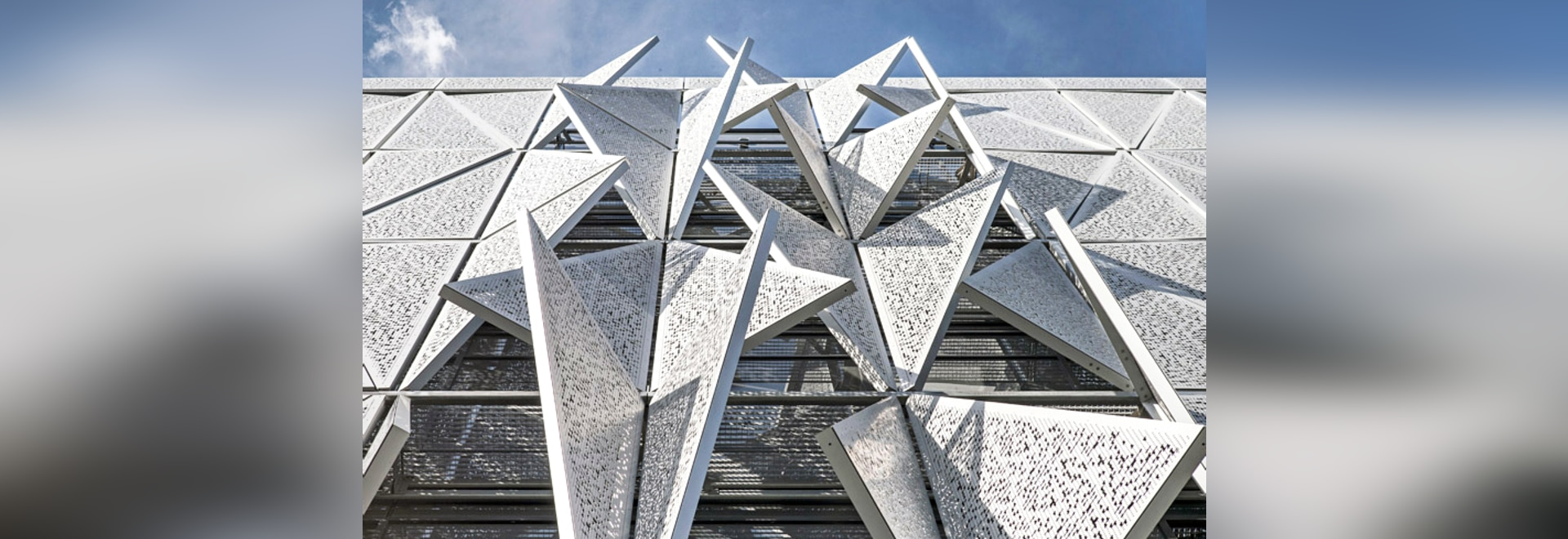 Facade pattern architecture  This building's geometric facade transforms to regulate daylight ...