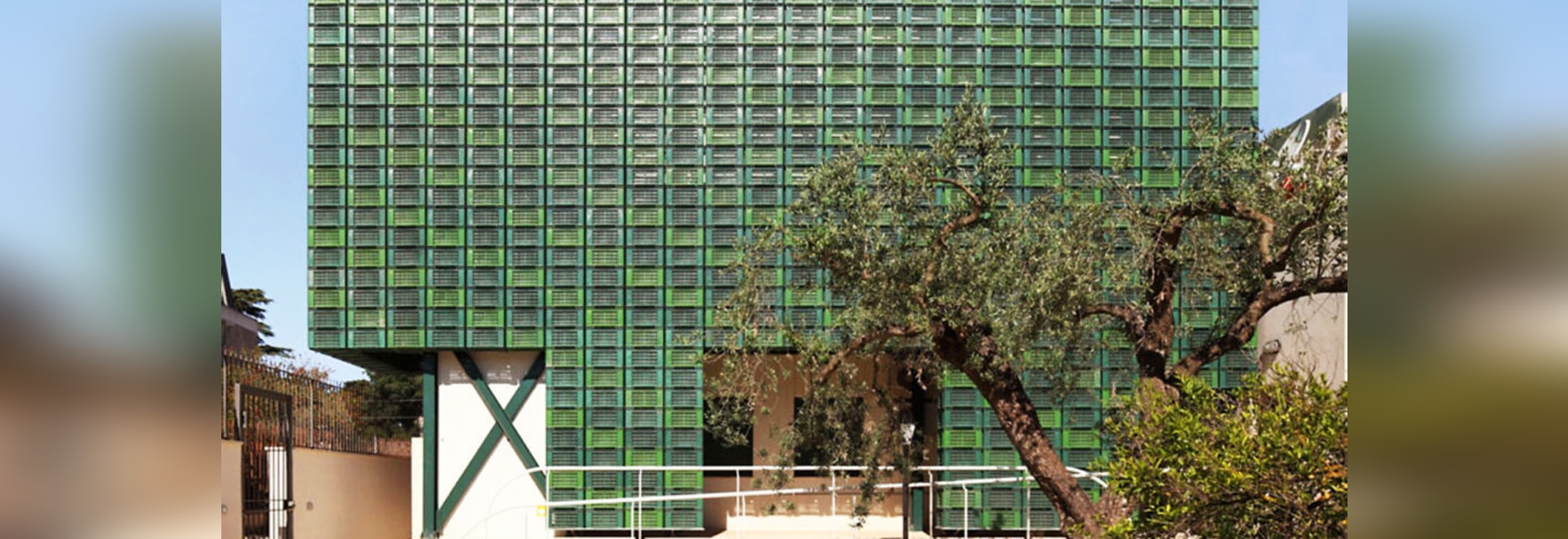 Hundreds of repurposed orange crates make up striking facade in Italy