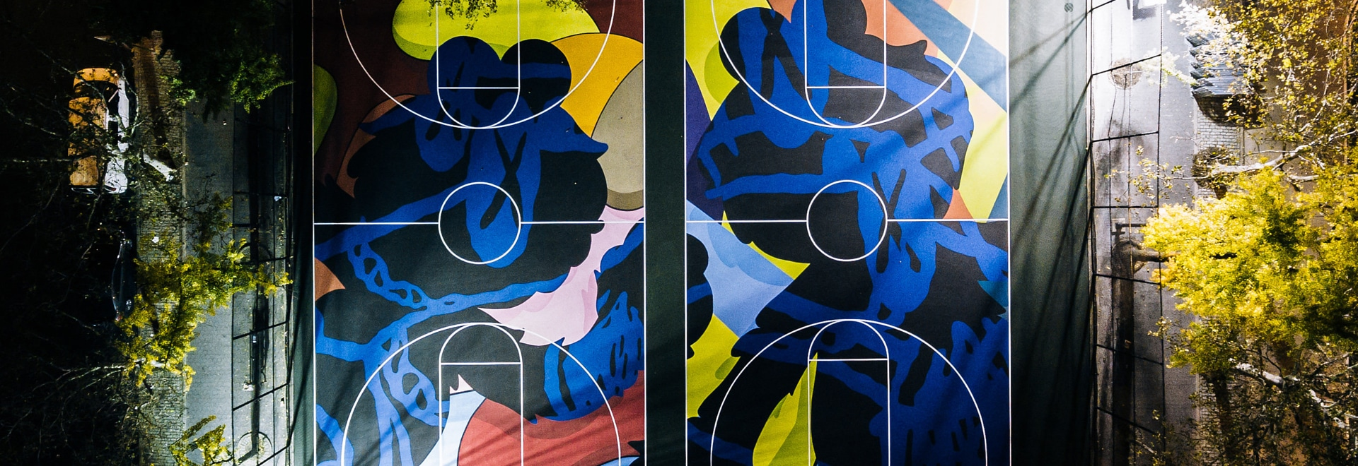 Kaws covers New York basketball courts in colourful murals