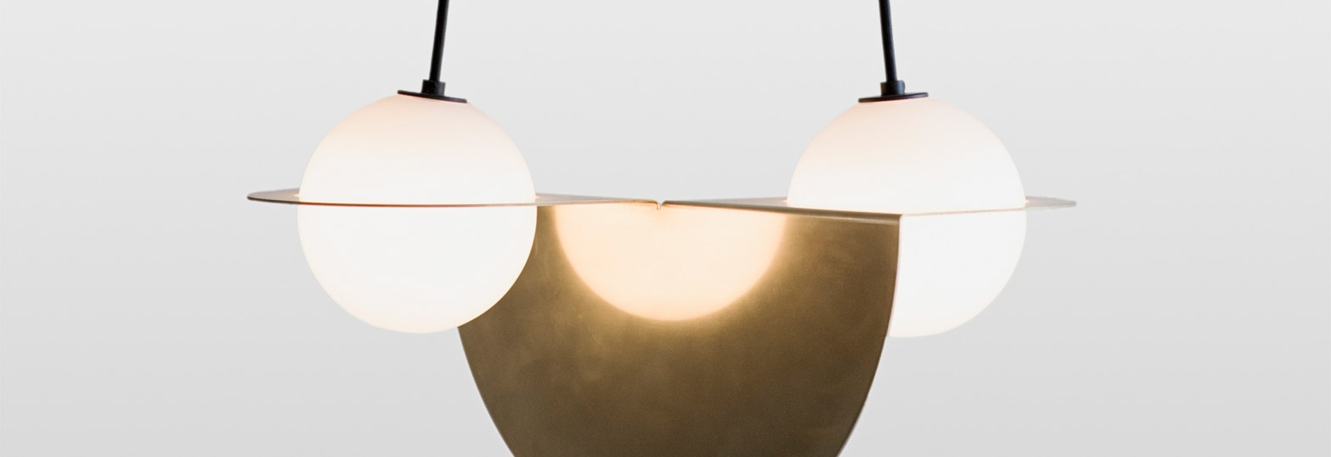 Lambert & Fils puts a spin on traditional globe pendants with Laurent lighting collection