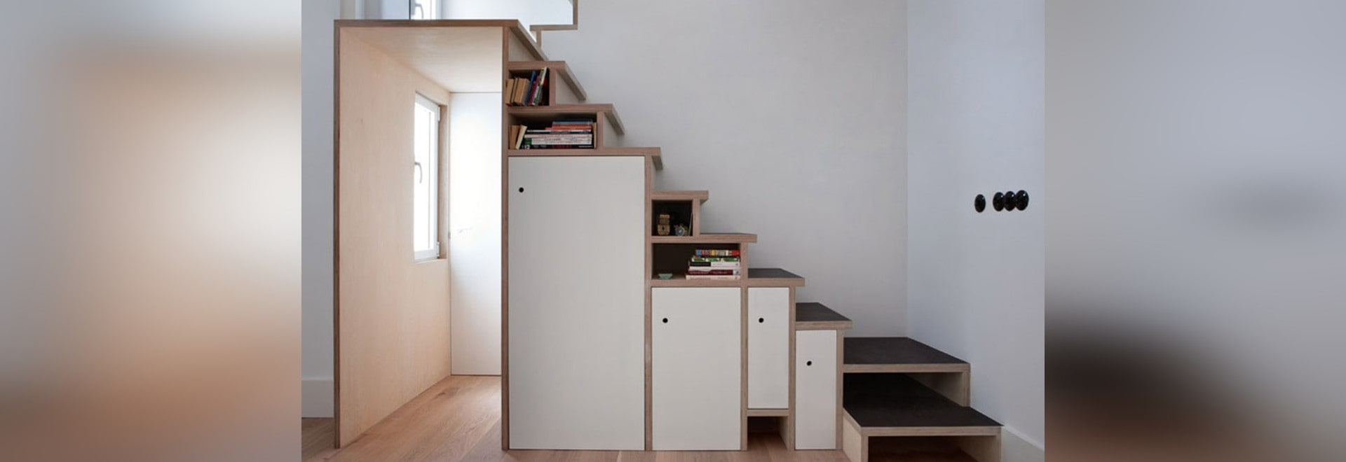 Plywood Staircase By Buj+Colón Arquitectos Integrates Shelves And Cupboards  For A Small Flat