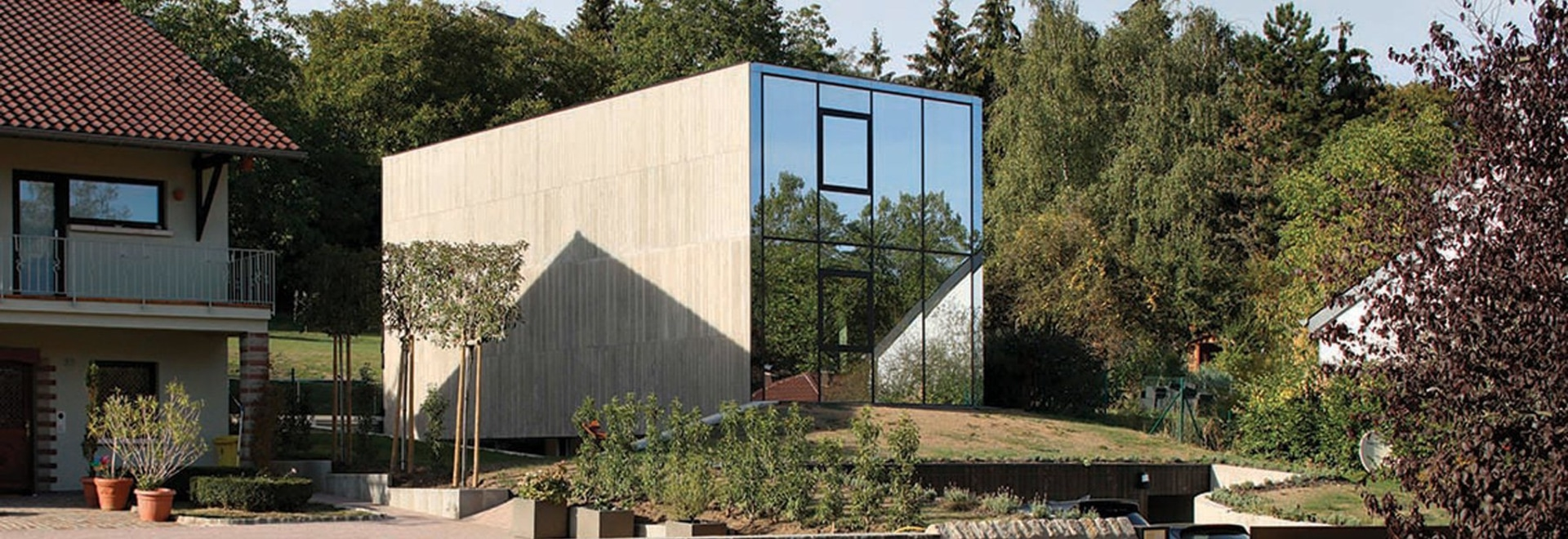 single-family house by 2001 juts like a concrete monolith from the ground