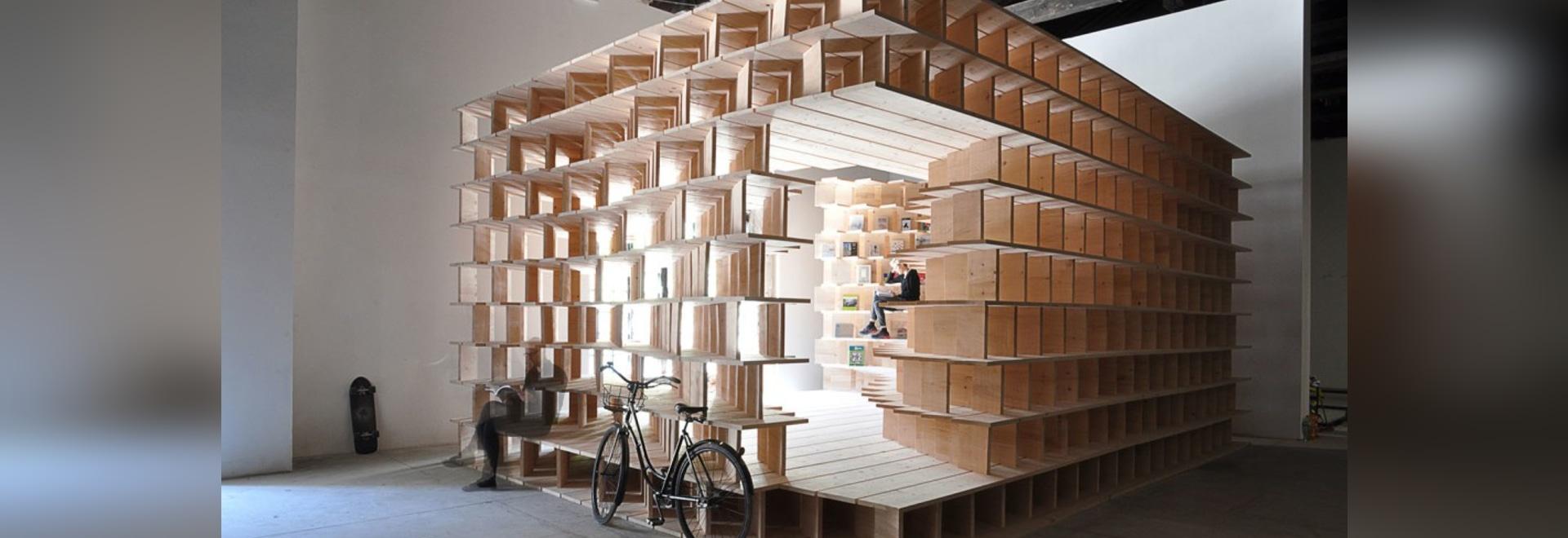Slovenia Built A Habitable Structure With Latticed Wooden Bookshelves