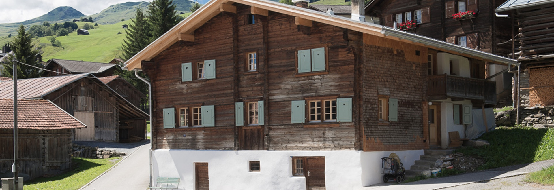 A Traditional Ski Chalet In The Swiss Alps Has Been Transformed Into Two Timber Clad