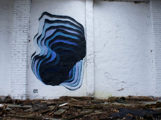 1010'S SPRAY PAINT ART REVEALS COLORFUL PORTALS IN WALLS AND BUILDINGS
