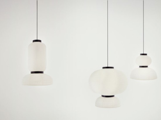 the lamps are in an ivory white color where the contrasting shape is highlight with a rim of black stained oak