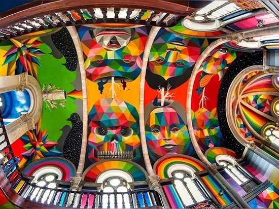 okuda san miguel paints colorful mural within converted church's indoor skate park