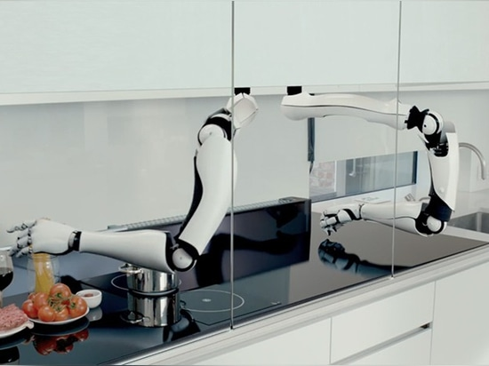 the two robotic arms run a long the entire length of the kitchen counter