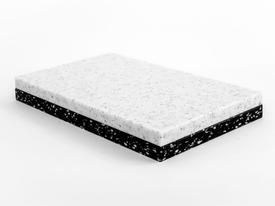 'Black Stracciatella', the latest launch by My Kilos, uses black polyethylene speckled with white flakes to form a contemporary collection. Pictured: 'Piece of Plastic' cutting boards