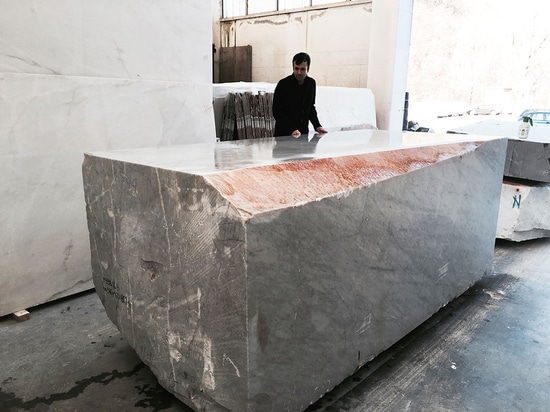 The ambitious project was not without its challenges, not least the sheer magnitude of the marble sofa which weighs in at six tonnes. Pictured: Cocksedge with the unsculpted marble block