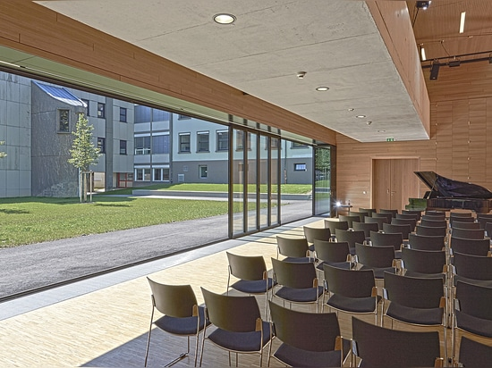 SL 82 folding glass door  Multi-purpose hall and open-air stage in one