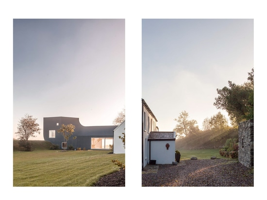 The house blends traditional materials such as stone with the liquid plastic cladding of the modern extension.