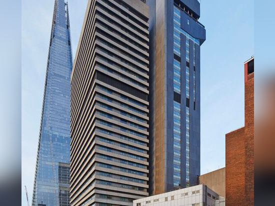 "Penoyre & Prasad reclads ""ugly"" London hospital tower with origami-like skin"