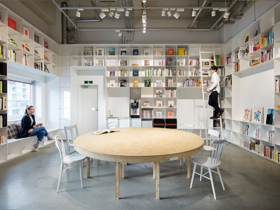 schemata combines a library and cake shop for tokyo based kitchen 'hue'