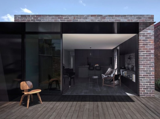 Recycled bricks add rugged contrast to this contemporary Sydney home