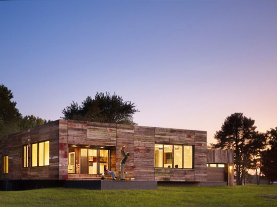 Vernacular-inspired Delaware home built with recycled barn wood
