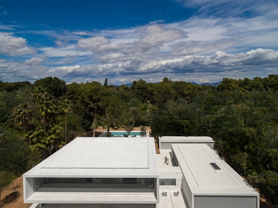 fran silvestre nestles expansive pool house in the woods of valencia