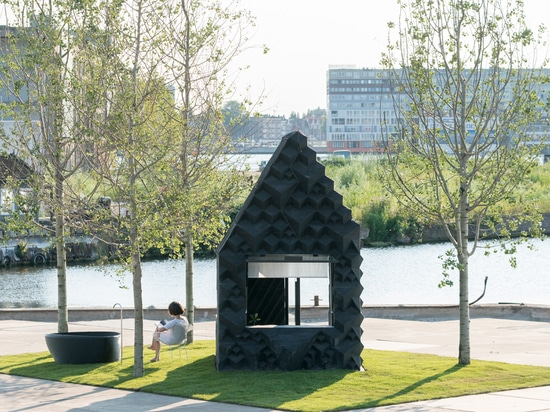 3D printed urban cabin by DUS architects sits along amsterdam's canalside