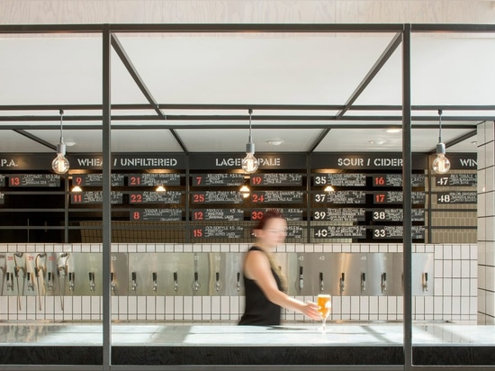Mammoth cafe and craft beer bar in Seattle accommodates different social spaces