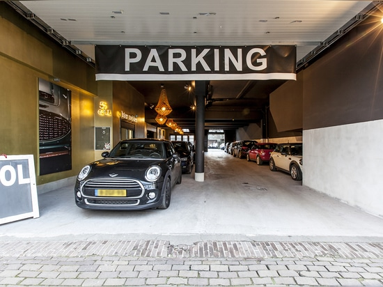 JSPR Golden crowns lighting up a garage in Amsterdam
