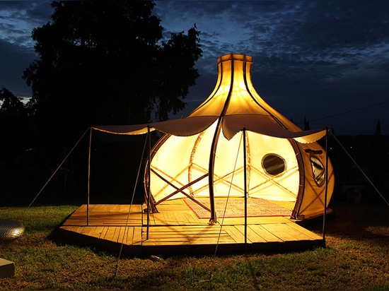 giant grass creates froute pod for glamorous camping