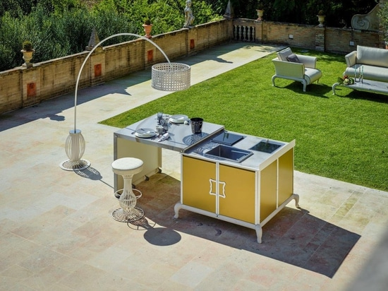 Island outdoor kitchen with integrated table