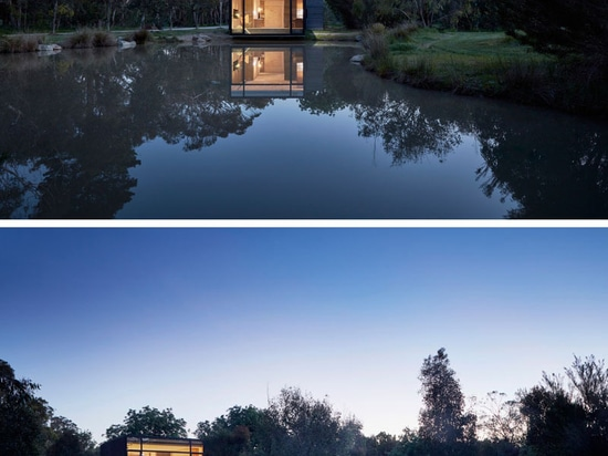 This small building next to a pond was designed to be used as a yoga studio and home office