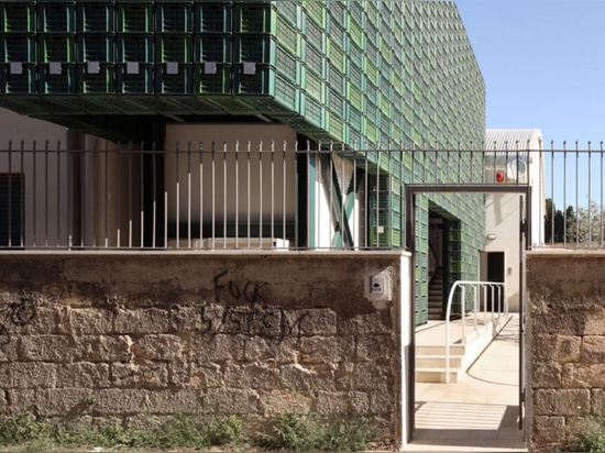 Hundreds of repurposed orange crates make up striking facade in Italy