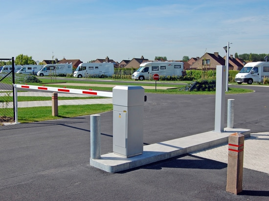 Access control using automatic barriers and card readers for campsites and mobile home sites.