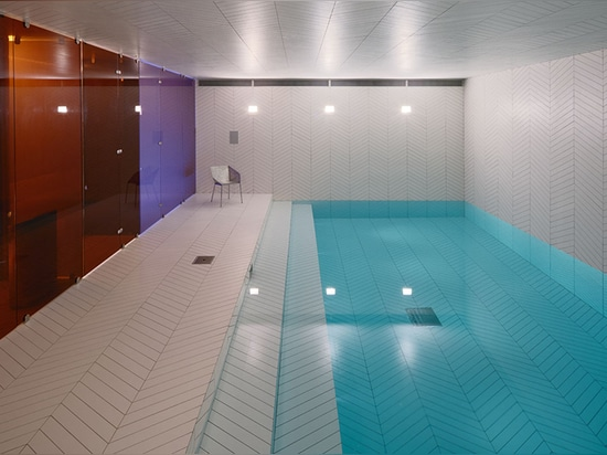 claesson koivisto rune wraps entire swedish pool and spa in parquet tiles