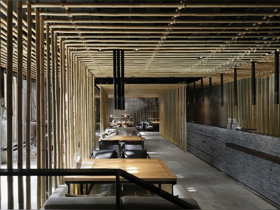 minggu design installs bamboo canes as visual guides in chinese eatery