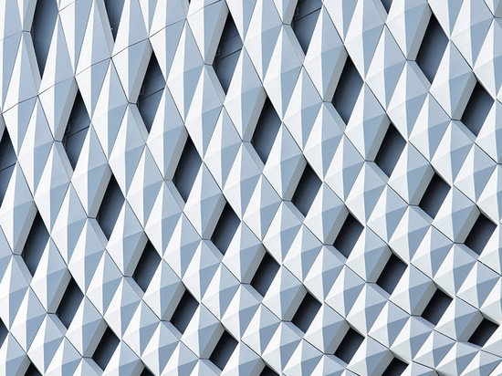 klein dytham applies patterned façade to ginza place development in tokyo