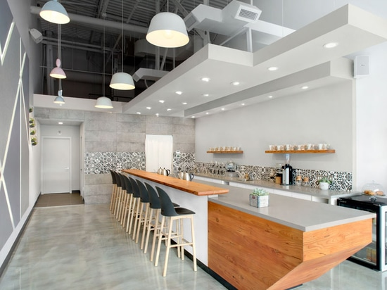 This Modern Coffee Shop Has A Palette Of Grey, White, And Wood