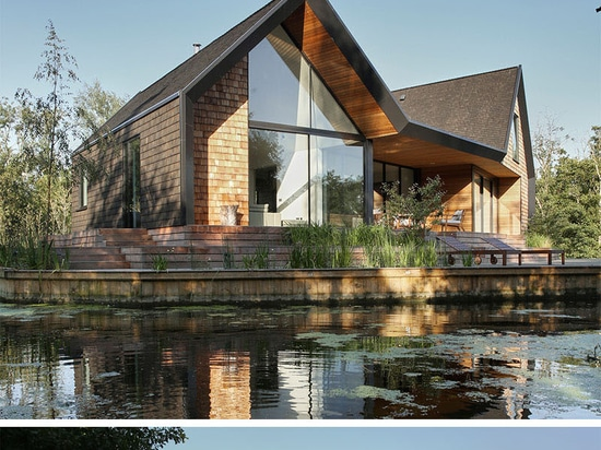 This house for a family was built next to a secluded lagoon in England